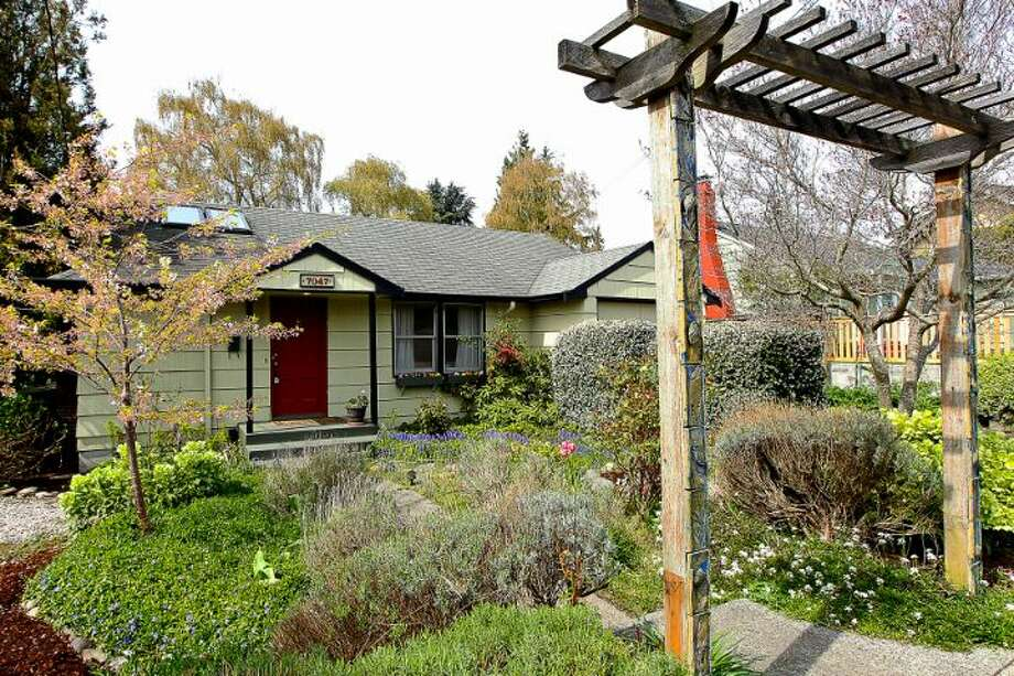Ravenna is a popular northeast Seattle neighborhood convenient to the University of Washington and downtown. Here are four homes there for between $465,000 and $485,000, starting with 7047 21st Ave. N.E. The 2,260-square-foot house, built in 1948, has three bedrooms, two bathrooms, a living room with a huge skylight, a family room and a large deck on a 6,000-square-foot lot. It's listed for $465,000, although a sale is pending. Photo: Courtesy Steve Laevastu/Windermere Real Estate