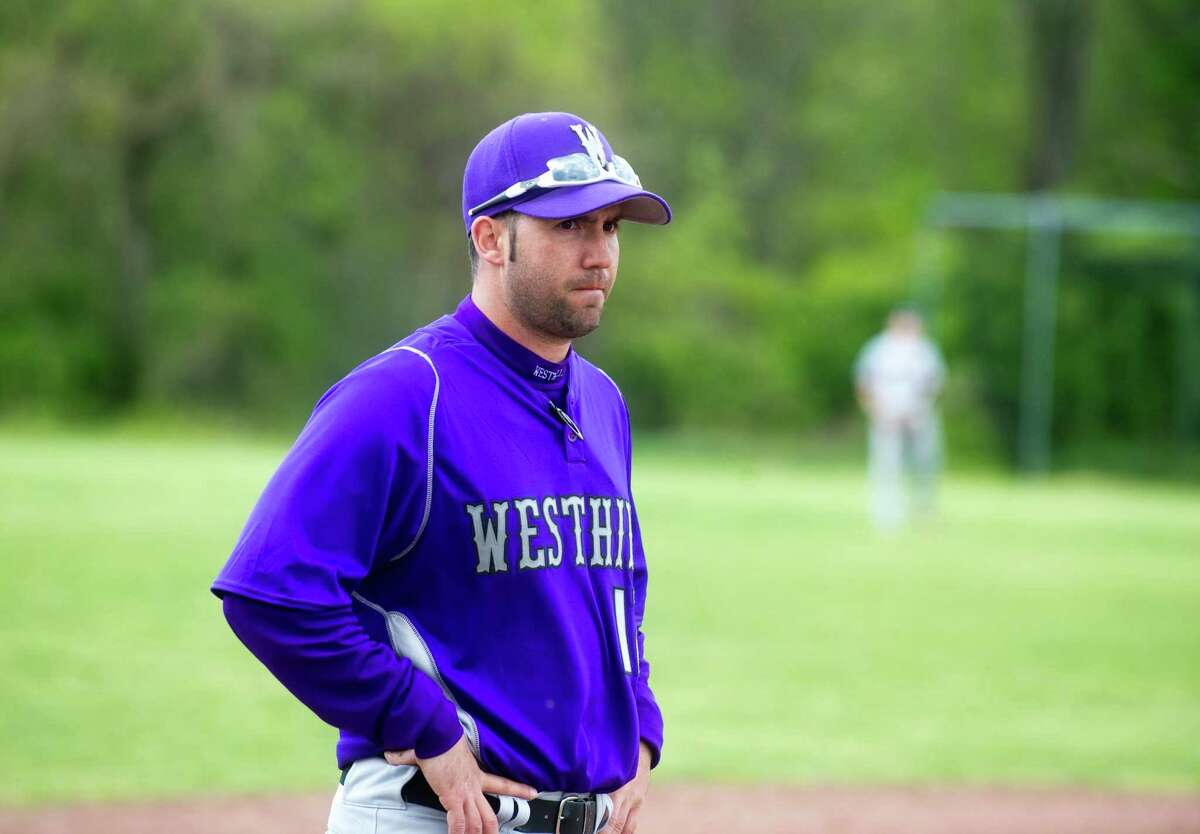 Westhill Coach DJ Mulvany watches as Westhill High School hosts Fairfield Warde in a baseball game in Stamford, Conn., April 24, 2012.