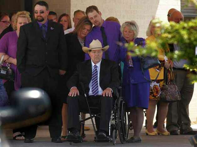 Family members view the remains of Kala Marie Golden-Schuchardt taken away upon the conclusion of the funeral service for Kala Marie Golden-Schuchardt at First Baptist Church on Tuesday, April 24, 2012, in Willis.  Kala Marie Golden-Schuchardt, age 28 of Spring, Texas passed away on Tuesday, April 17, 2012 in the Woodlands. Verna McClain is accused of shooting Kala Golden-Schuchardt to death as she was leaving the Northwoods Pediatric Center, and kidnapping Keegan Schuchardt. Photo: Mayra Beltran, . / © 2012 Houston Chronicle