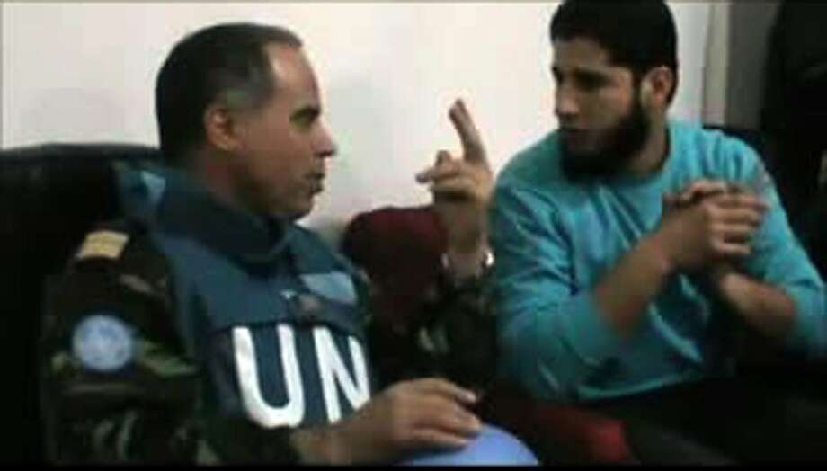 "An image grab taken from a video uploaded on youtube on April 24, 2012, purportedly shows Moroccan UN observer, Colonel Ahmed Himmiche, speaking Abdul Razzaq Tlas (R), leader of the opposition Katibat al-Faruqin, during his visit to the restive central city of Homs. AFP PHOTO/HO  --    RESTRICTED TO EDITORIAL USE - MANDATORY CREDIT ""AFP PHOTO / HO / YOUTUBE"" - NO MARKETING NO ADVERTISING CAMPAIGNS - DISTRIBUTED AS A SERVICE TO CLIENTS - AFP IS USING PICTURES FROM ALTERNATIVE SOURCES AS IT WAS NOT AUTHORISED TO COVER THIS EVENT, THEREFORE IT IS NOT RESPONSIBLE FOR ANY DIGITAL ALTERATIONS TO THE PICTURE'S EDITORIAL CONTENT, DATE AND LOCATION WHICH CANNOT BE INDEPENDENTLY VERIFIED (Photo credit should read -/AFP/Getty Images) Photo: -, AFP/Getty Images"