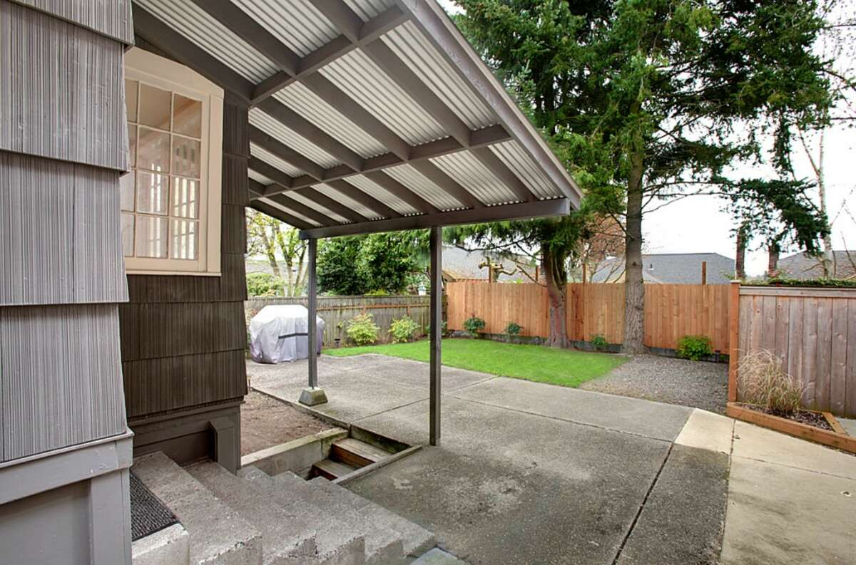 This 2,160-square-foot Seattle house, built in 1915, has two bedrooms and a bathroom upstairs, plus a bedroom, three-quarter bathroom and kitchen in a basement mother-in-law apartment. It also features crown molding, wainscoting and a front patio on a 3,315-sqoare-foot lot.