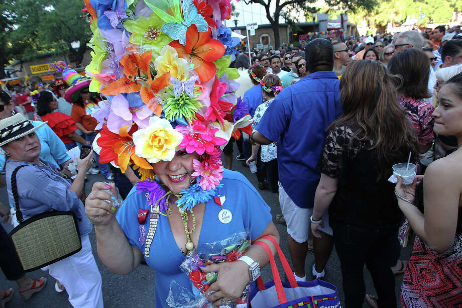 Minu Martinez wears her self-made creation, Flower Power, to everyone's fascination at the first night of a Night in Old San Antonio on Tuesday, Apr. 24, 2012. Photo: Kin Man Hui, Kin Man Hui/Express-News / ©2012 San Antonio Express-News