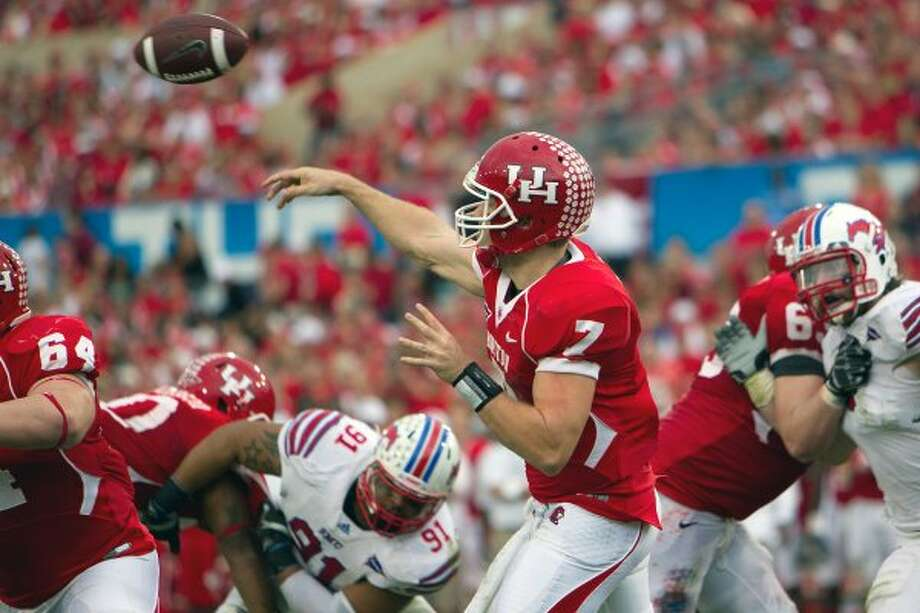 Case Keenum, University of Houston (2007-11)  Entering the TicketCity Bowl, Keenum has thrown this year for 5,099 yards and 45 TDs and is the only FBS player to surpass 5,000 yards in a season three times. He holds NCAA career records for career TD passes, yards and completions and won the 2011 Sammy Baugh Award. (Smiley N. Pool / Houston Chronicle)