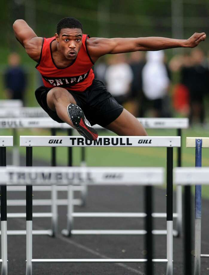 Central's Andre Aiken competes in the 110 meter hurdles Tuesday, April 24, 2012 during a track meet with Staples and Trumbull at Trumbull High School. Photo: Autumn Driscoll / Connecticut Post