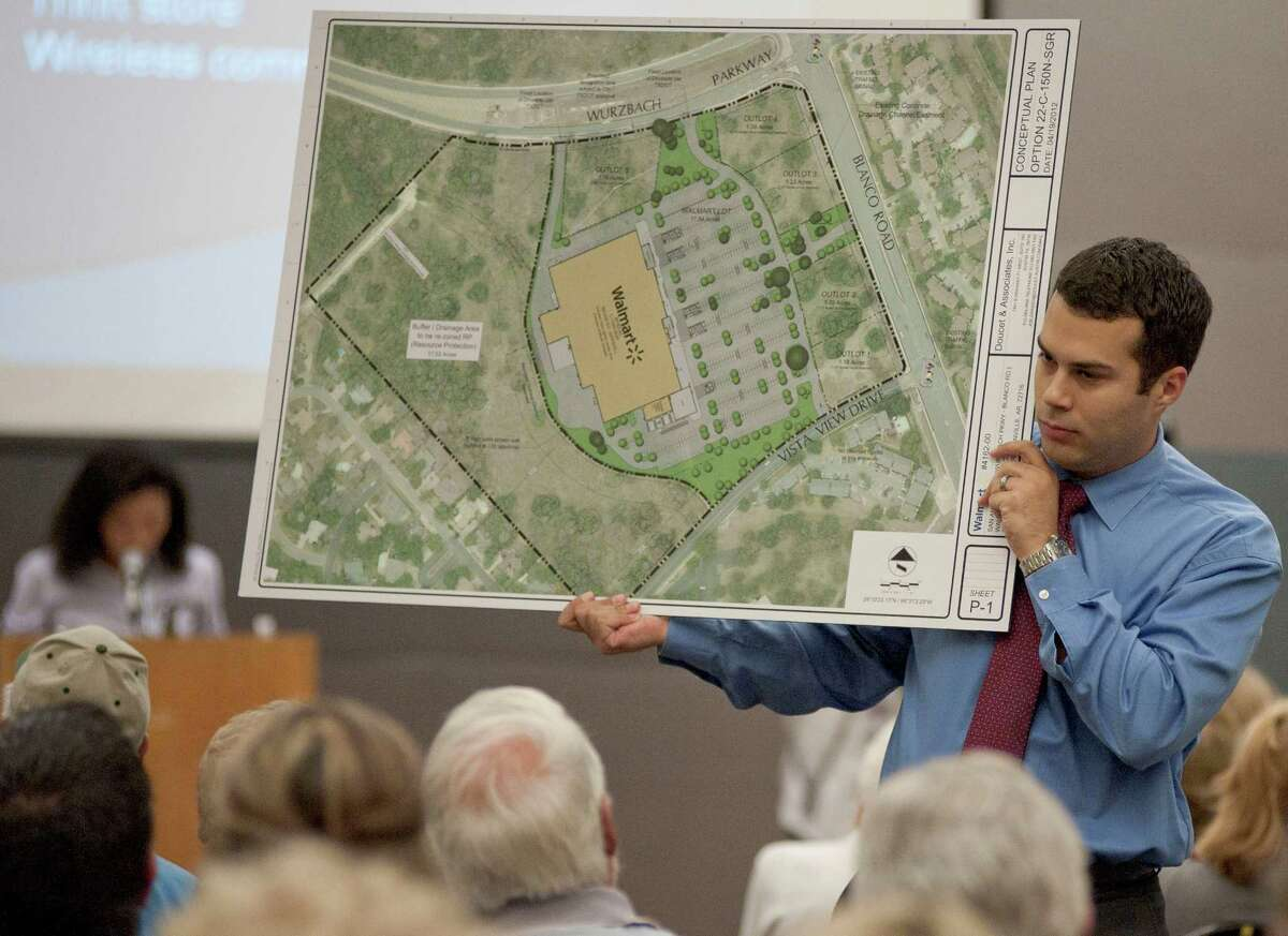 Jeff Bazan, chief of staff for San Antonio City Councilwoman Elisa Chan, holds up a graphic for attendees at a meeting to discuss a proposal for a new Wal-Mart at the corner of Blanco Rd. and Wurzbach Pkwy, Tuesday, April 24, 2012, at the Jewish Community Center in San Antonio.