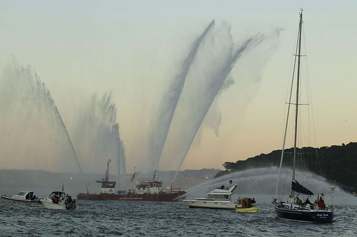 The fireboat Phoenix, of the San Francisco Fire Department, sprays water during a memorial flotilla for five sailors who were killed in a yacht race last weekend, in Belvedere, Calif., Saturday, April 21, 2012. Nearly a hundred boats from throughout the Bay area took part in the flotilla to honor the crew members of the Low Speed Chase who died April 14 during the Full Crew Farallones Race off the Northern California coast. (AP Photo/Eric Risberg)