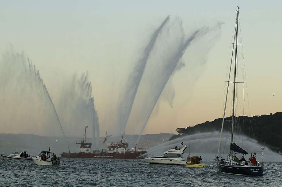 The fireboat Phoenix, of the San Francisco Fire Department, sprays water during a memorial flotilla for five sailors who were killed in a yacht race last weekend, in Belvedere, Calif., Saturday, April 21, 2012. Nearly a hundred boats from throughout the Bay area took part in the flotilla to honor the crew members of the Low Speed Chase who died April 14 during the Full Crew Farallones Race off the Northern California coast. (AP Photo/Eric Risberg) Photo: Eric Risberg, Associated Press