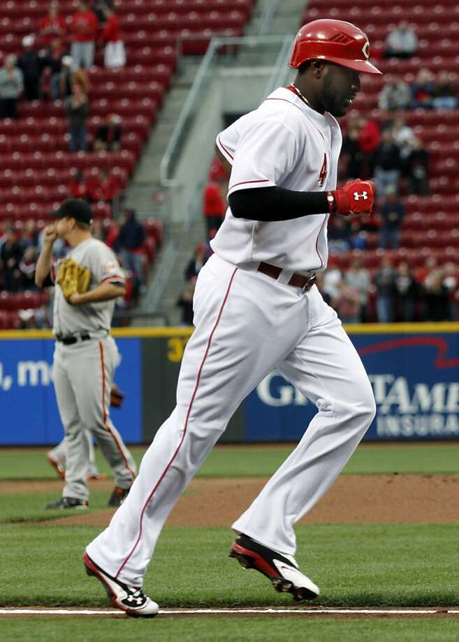 Cincinnati Reds' Brandon Phillips heads to home plate after hitting a two-run home run off San Francisco Giants pitcher Matt Cain, left, in the first inning of their baseball game in Cincinnati, Tuesday, April 24, 2012. (AP Photo/Tom Uhlman) Photo: Tom Uhlman, Associated Press