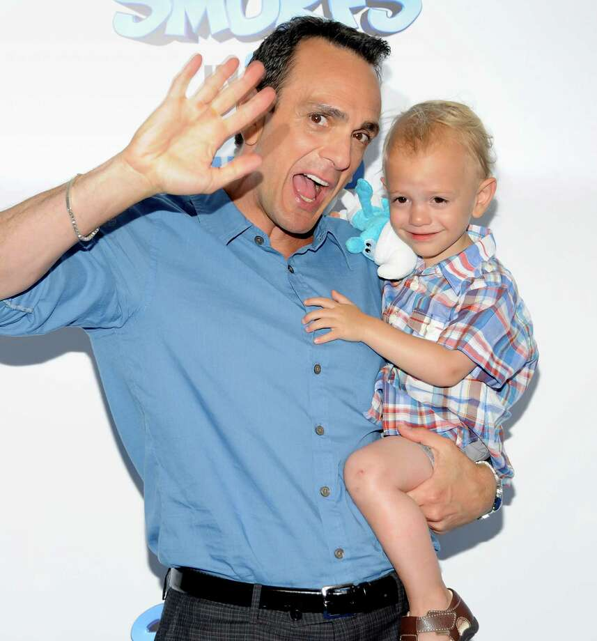 "Actor Hank Azaria and son Hal attend the premiere of ""The Smurfs"" at the Ziegfeld Theatre on Sunday, July 24, 2011 in New York. (AP Photo/Evan Agostini) Photo: Evan Agostini / AGOEV"
