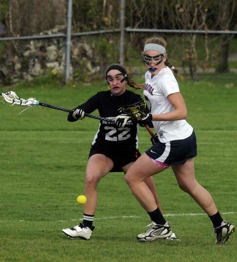 Saratoga Springs senior midfielder Isabella Wager, right, and Bethlehem's Amanda Fleming battle for