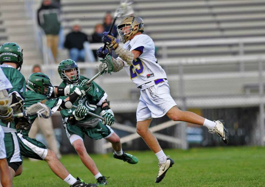 CBA's Andy Curro, right, scores the game winning goal in overtime to defeat Shenendehowa, 14-13, on Tuesday April 24, 2012 in Colonie, NY. (Philip Kamrass / Times Union ) Photo: Philip Kamrass / 00017364A