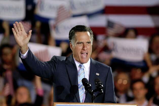 Republican presidential candidate, former Massachusetts Gov. Mitt Romney takes the stage at an election night rally in Manchester, N.H., Tuesday, April 24, 2012. (AP Photo/Jae C. Hong) Photo: Jae C. Hong