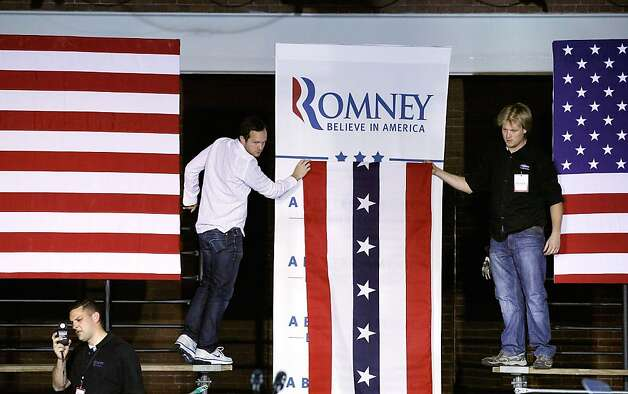 "Campaign workers hang banners in preparation for a rally with Republican presidential candidate, former Massachusetts Gov. Mitt Romney at the Raddisson Hotel April 24, 2012 in Manchester, New Hampshire.  In a speech titled ""A Better America Begins Tonight,"" Romney will deliver remarks on the day as primary voters head to the polls in New York, Connecticut, Delaware, Rhode Island and Pennsylvania. Photo: Chip Somodevilla, Getty Images"