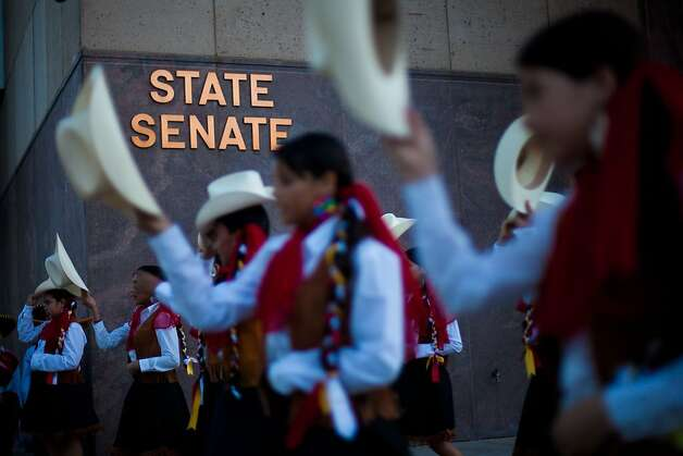 PHOENIX, AZ - APRIL 24:  Children dance during a vigil at the Arizona state Capitol April 24, 2012 in Phoenix, Arizona. The United Farm Workers (UFW) has planned a day of protest and vigils at the Arizona state Capitol April 24, the day before the U.S. Supreme Court hears arguments over Arizona's 2010 immigration enforcement law. (Photo by Jonathan Gibby/Getty Images) Photo: Jonathan Gibby, Getty Images