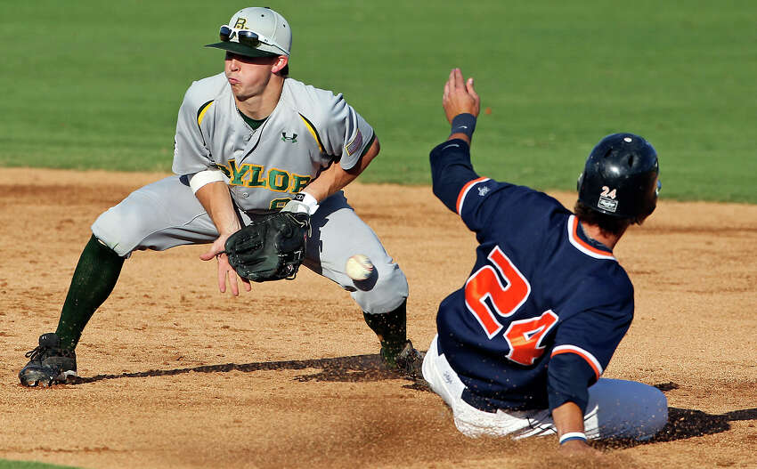 The Roadrunners' Daniel Rockett gets into second base safely as Bears second baseman Lawton Langford misses the catch from the plate in the third inning as UTSA hosts Baylor at Wolff Stadium on Tuesday, April 24, 2012.