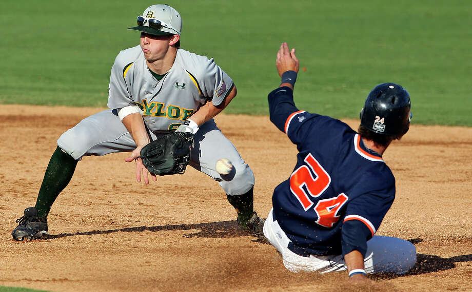 The Roadrunners' Daniel Rockett gets into second base safely as Bears second baseman Lawton Langford misses the catch from the plate in the third inning as UTSA hosts Baylor at Wolff Stadium on Tuesday, April 24, 2012. Photo: TOM REEL, San Antonio Express-News / San Antonio Express-News