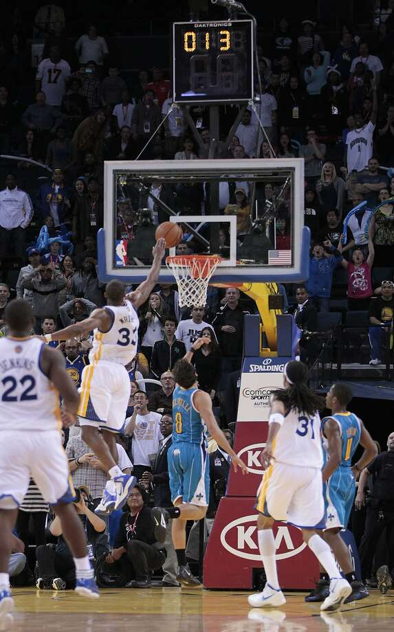 Golden State Warriors forward Chris Wright (33) goal tends a shot by New Orleans Hornets shooting guard Marco Belinelli (8) for the winning score of an NBA basketball game in Oakland, Calif., Tuesday, April 24, 2012. The Hornets defeated the Warriors 83-81. (AP Photo/Paul Sakuma) Photo: Paul Sakuma, Associated Press