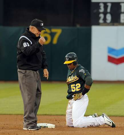 Yoenis Cespedes caught stealing in the second inning. The Oakland Athletics played the Chicago White Sox at the O.co Coliseum in Oakland, Calif., on Tuesday, April 24, 2012. The A's defeated the Sox 2-0. Photo: Carlos Avila Gonzalez, The Chronicle