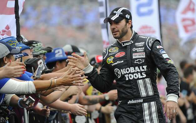 In this April 14, 2012, photo, Jimmie Johnson greets fans before the NASCAR Sprint Cup Series auto race at Texas Motor Speedway in Fort Worth, Texas. Forbes' annual ranking of America's Most Influential Athlete has placed Johnson at the top of the list for the second consecutive year. The rankings are done by public opinion polling. Forbes says Tuesday that Nielsen and E-Poll surveyed over 1,100 adults about dozens of well-known athletes to measure their likeability and whether they are considered influential to marketers. (AP Photo/Ralph Lauer) Photo: Ralph Lauer, Associated Press