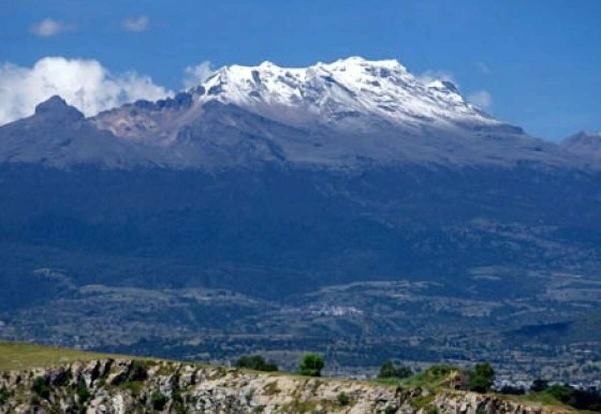 The Iztaccihuatl volcano, more than 16,000 feet above sea level, is a constant presence in Puebla.