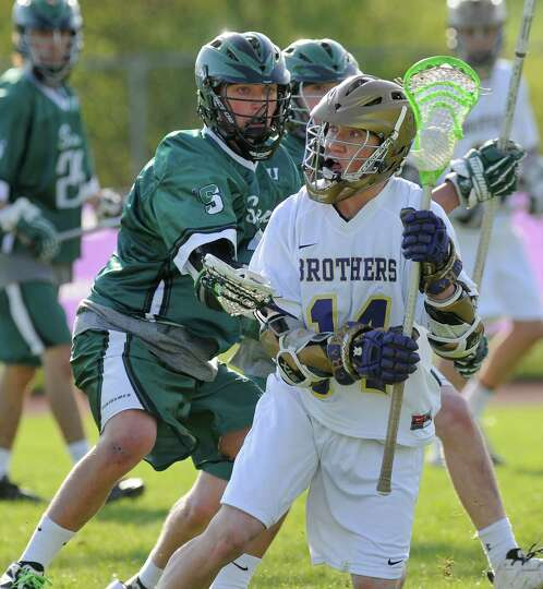 CBA's John Bassett handles the ball during the second half of their 14-13 overtime victory over Shen