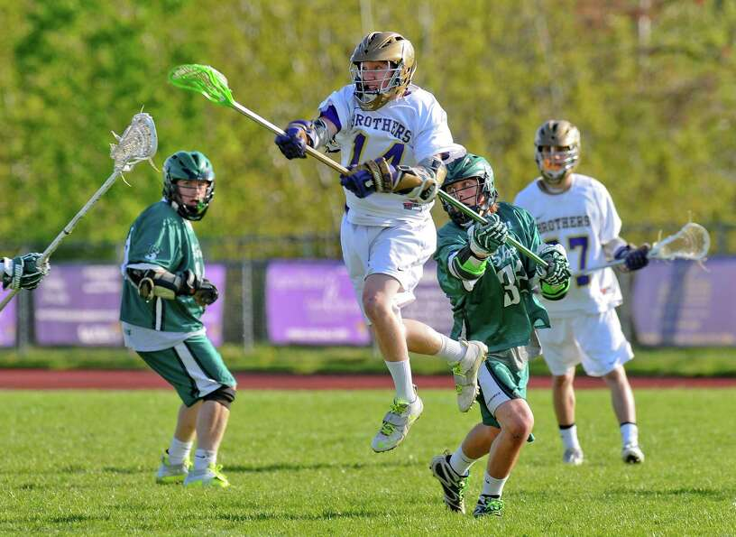 CBA's John Bassett goes airborne to tie the score at 10 in the second half of their 14-13 overtime v