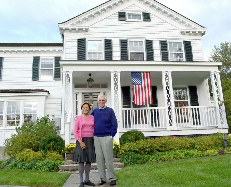 "Russell ""Russ"" Reynolds and his wife Debbie Reynolds will be honored with a Preservation Leader Award from the Greenwich Preservation Trust. Here the couple stand in front of their house on Taconic Road, which was built in 1848. Photo: Anne W. Semmes"