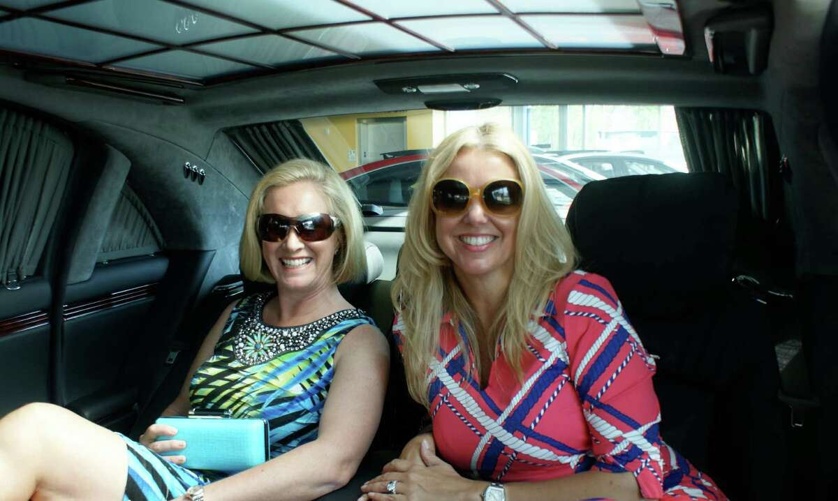 From left, Young Womenís League President Amy Burger and member Nancy Roeder pose in a Maybach at Mercedes-Benz of Greenwich, a sponsor for the upcoming Couture for a Cause fundraiser. Burger is wearing an outfit from Dorothy Mann and bag by Walin & Wolff. Roeder is wearing a look by J. McLaughlin.