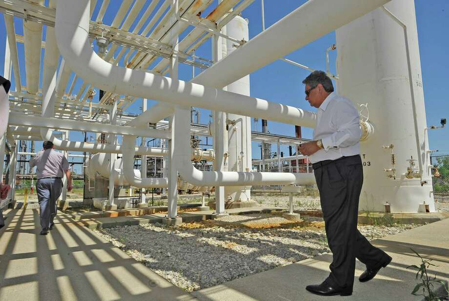 Al Salazar, CEO of Jefferson Refinery, LLC, walks around the site of what will become the Jefferson Refinery near Winnie, Tuesday April 24, 2012, which was once the Independent Refining Co. property, which closed 30 years ago. Attempts were made to refurbish and reopen the facility, but it never happened. The new company will have $300 million in capital through Jefferson County-approved Industrial Development Corp. bonds, which do not obligate taxpayers. The company also wants to build a terminal at the Port of Beaumont's Orange County dock.   Dave Ryan/The Enterprise Photo: Dave Ryan