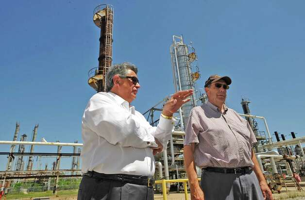 Al Salazar, left, CEO of Jefferson Refinery, LLC, and Gary Reeves, right, a Process Engineer, walk around the site of what will become the Jefferson Refinery near Winnie Tuesday April 24, 2012.  This facility was once the Independent Refining Co. property, which closed 30 years ago. Attempts were made to refurbish and reopen the facility, but it never happened. The new company will have $300 million in capital through Jefferson County-approved Industrial Development Corp. bonds, which do not obligate taxpayers. The company also wants to build a terminal at the Port of Beaumont's Orange County dock.   Dave Ryan/The Enterprise Photo: Dave Ryan
