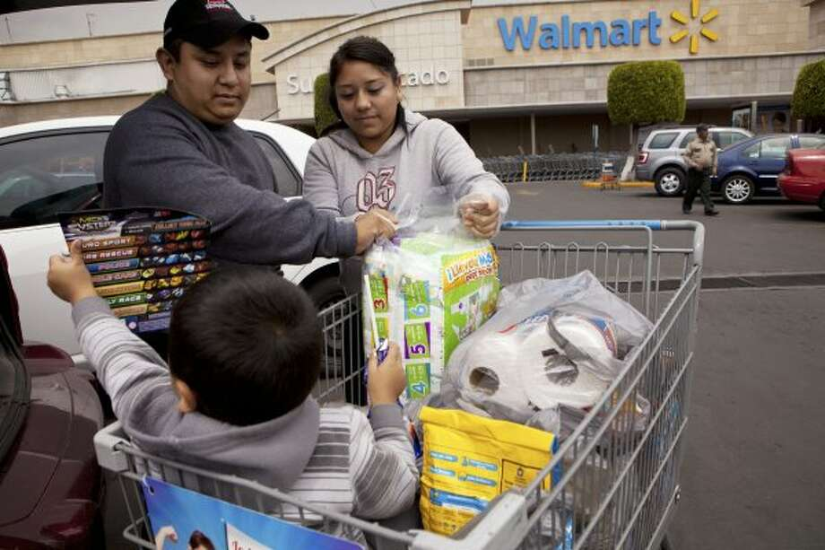 Shoppers at a Walmart store in Mexico City, March 29, 2012. in the mid-2000s, Wal-Mart de Mexico was the company's brightest success story. Confronted with evidence of widespread corruption in Mexico, top Wal-Mart executives focused more on damage control than on rooting out wrongdoing, an examination by The New York Times found. (Josh Haner/The New York Times) (New York Times)