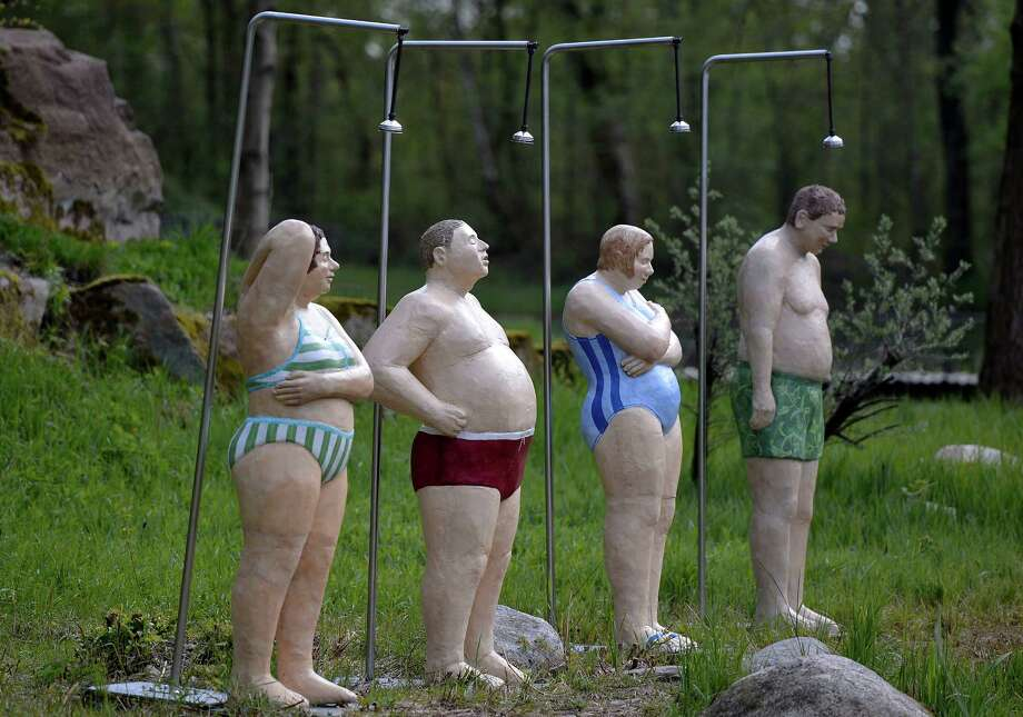 "Life-size figures made of concrete by artist Cristel Lechner are shown at the Maximilian park in Hamm, western Germany, Wednesday. The German artist installed 80 figures open air all over the park for her exhibition ""Ordinary People"". Photo: Martin Meissner, AP / AP"