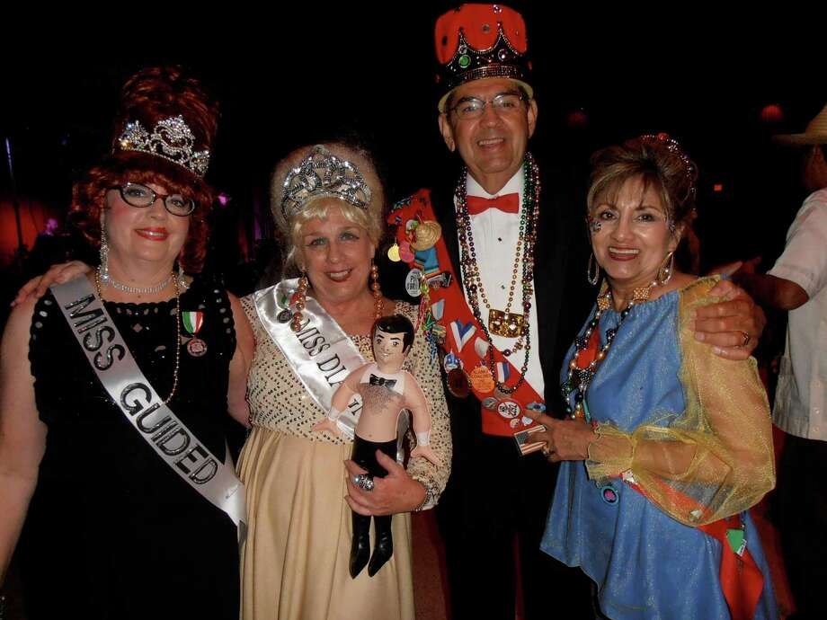 Faded Fiesta queens Elise Green, from left, and Kathy Moss celebrate their winning entry in the costume contest with Horace and Gloria Cardenas at the Urban-15 Incognito Masked Ball. Photo: Nancy Cook-Monroe