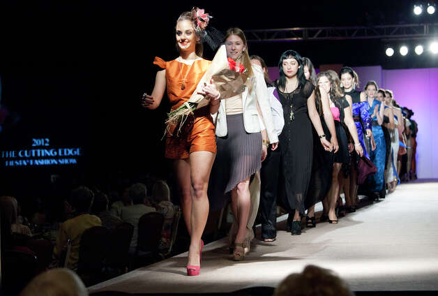 Designers followed by models take a final strut down the runway at the 32nd Annual The Cutting Edge Fiesta Fashion Show. Photo: J. Michael Short, For The Express-News / THE SAN ANTONIO EXPRESS-NEWS