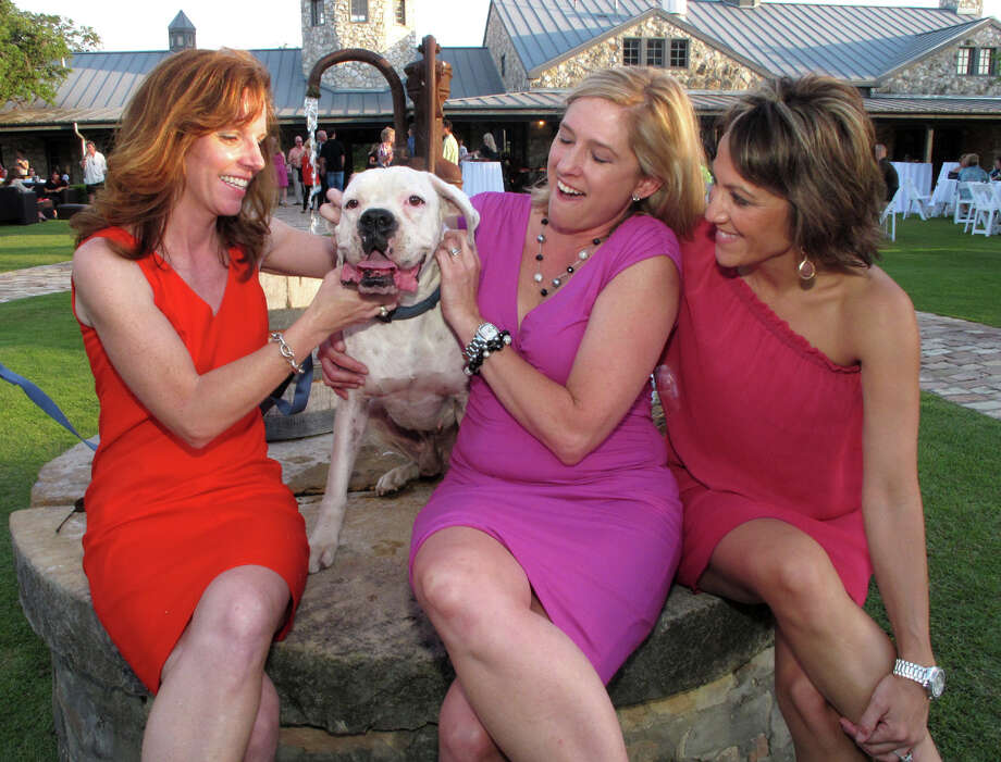 Animal Advocates President Laurie Galloway (from left) and Fido join Vice President Jennifer Vana and Secretary Jennifer Brower during the Animal Advocates Martinis for Mutts fundraiser at Canyon Springs Golf Club. Photo: Leland A. Outz, For The Express-News / SAN ANTONIO EXPRESS-NEWS