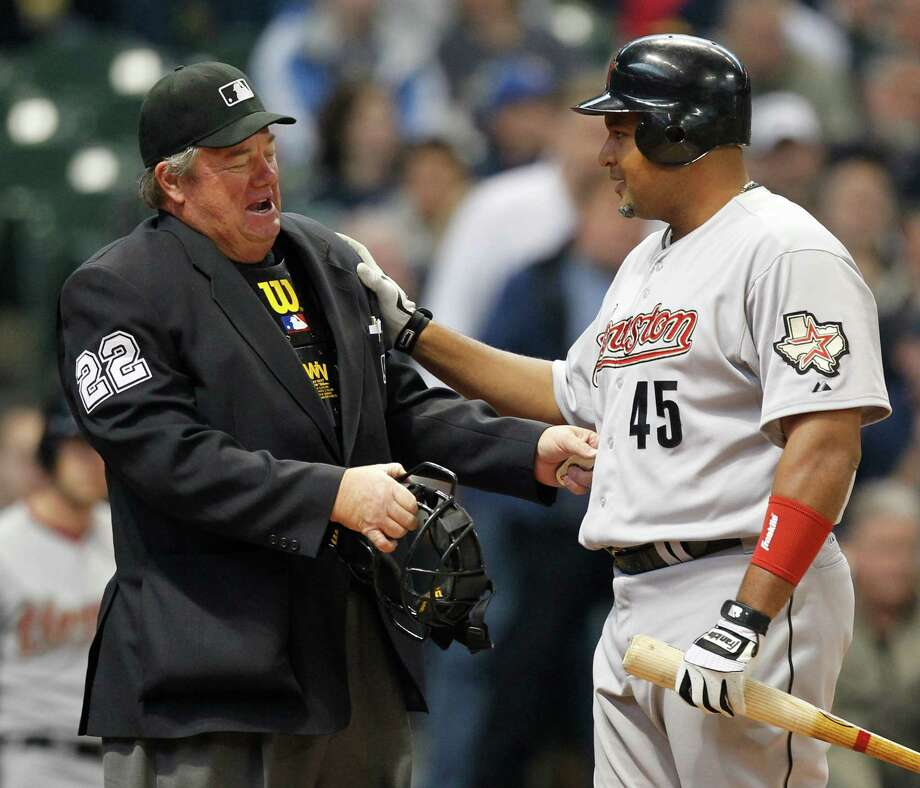 Houston Astros' Carlos Lee (45) talks to umpire Joe West during his at bat against the Milwaukee Brewers in the second inning of a baseball game, Wednesday, April 25, 2012, in Milwaukee. (AP Photo/Jeffrey Phelps) Photo: Jeffrey Phelps, Associated Press / FR59249 AP