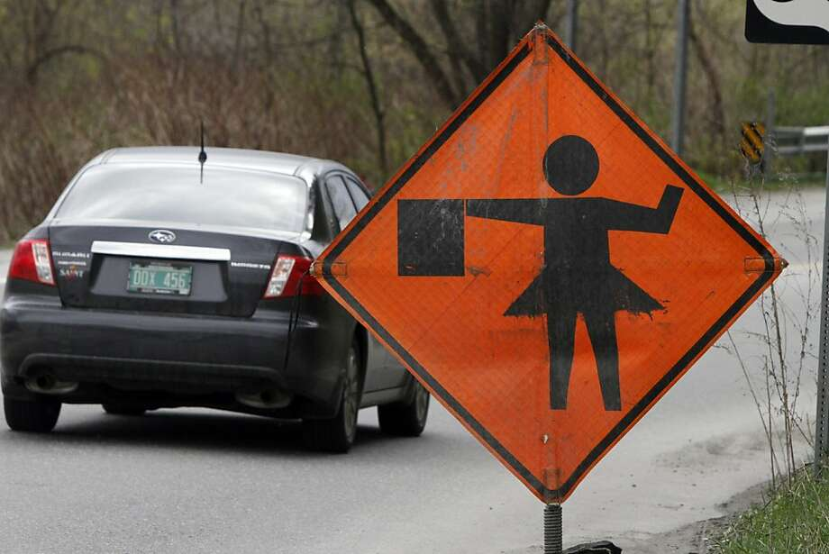 Slow down! Ballerinas are hard at work along Route 302 in Barre, Vt. Photo: Toby Talbot, Associated Press