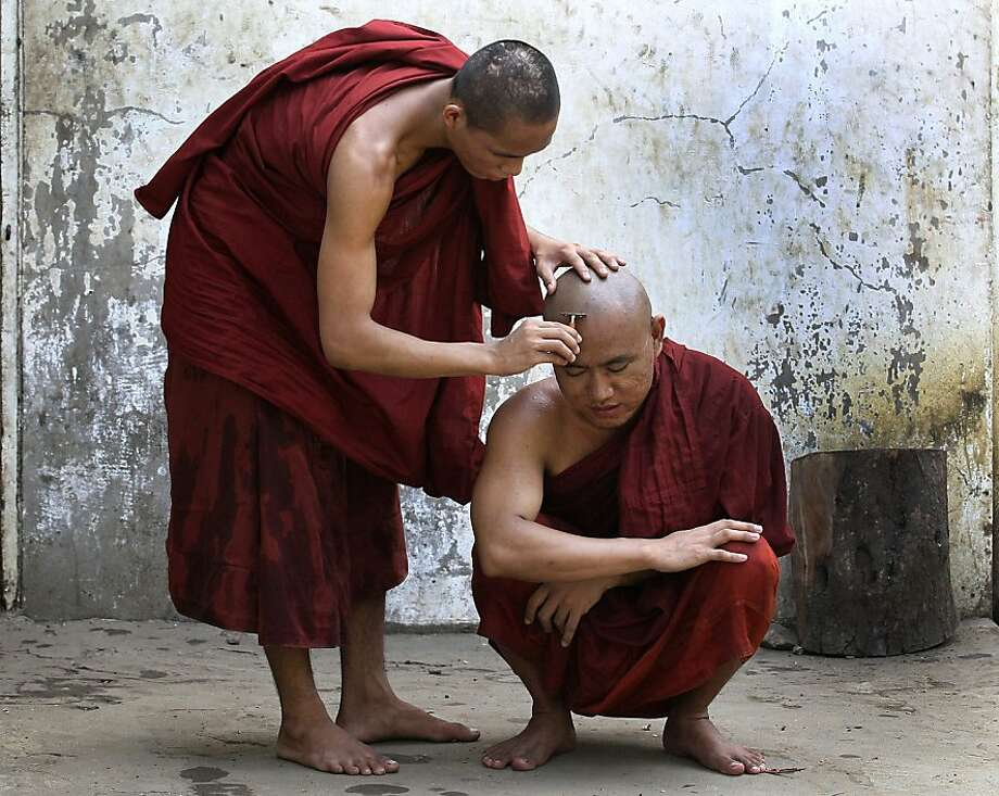 Sorry, we're all out of Foamy: A Buddhist monk shaves a fellow monk's head in Yangon, Myanmar. Photo: Sakchai Lalit, Associated Press