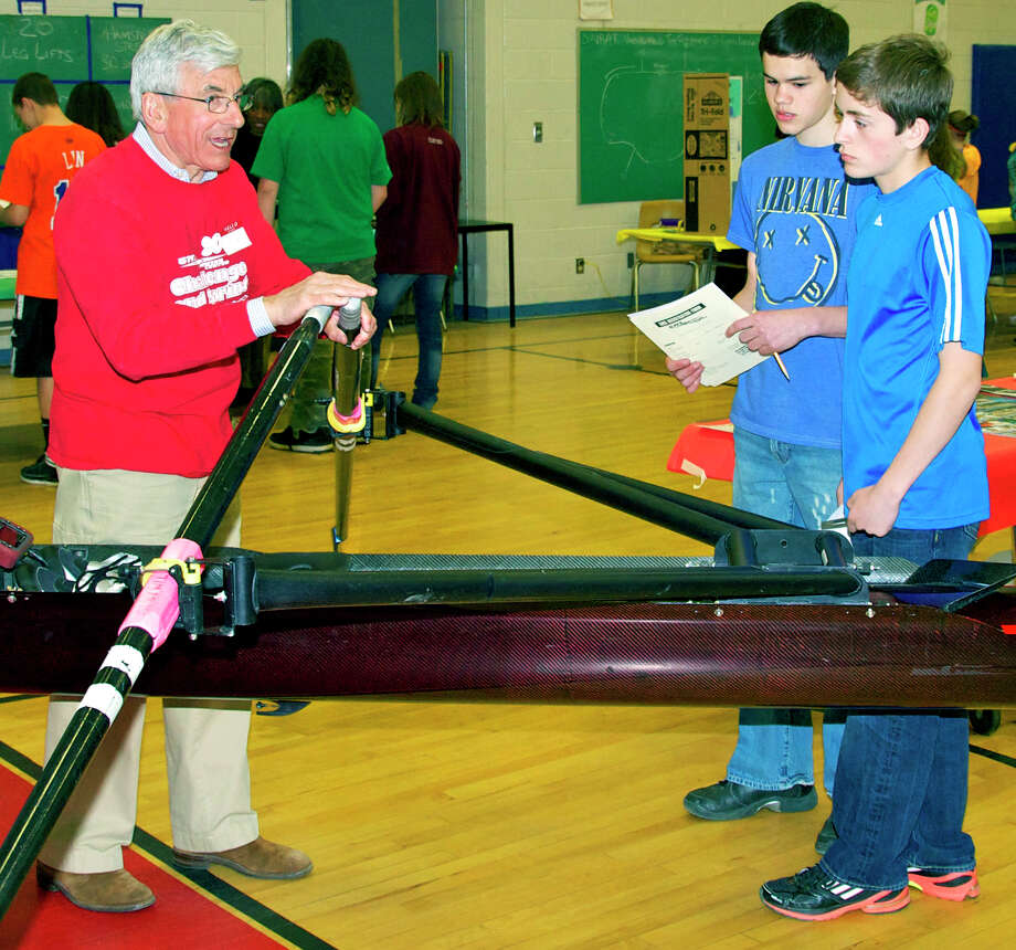 Tim Davies of the GMS Rowing Center in New Milford explains rowing technique to Schaghticoke Middle School eighth-grade students Kevin McWilliam, center, and Aidan Collentine during the school's April 11, 2012 health fair. Photo: Trish Haldin