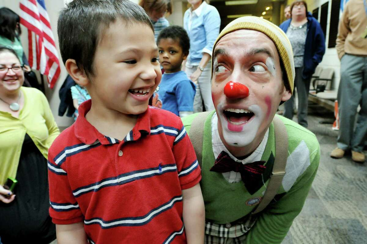 Watson Kawecki, right, a clown with Ringling Bros. and Barnum & Bailey, smiles with Gabe Davis, 4, on Wednesday, April 25, 2012, at the Center for Disability Services in Albany, N.Y. (Cindy Schultz / Times Union)