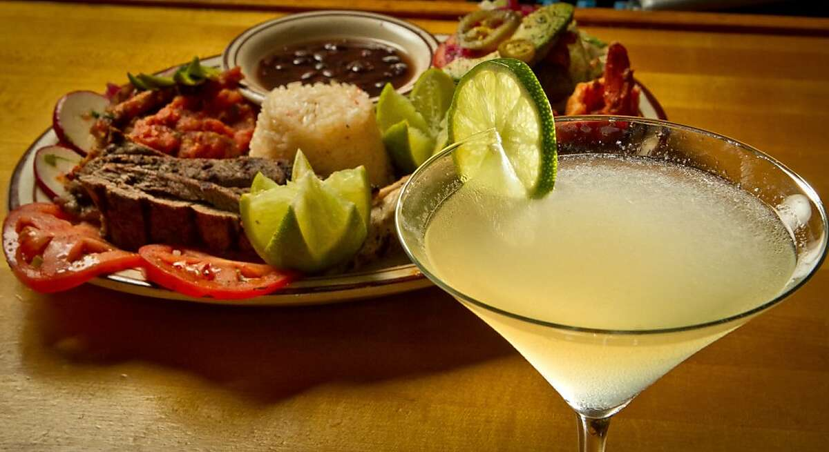 A Tommy's Margarita with a sampler platter of food at Tommy's Mexican Restaurant in San Francisco, Calif., is seen on Monday April 23rd, 2012.