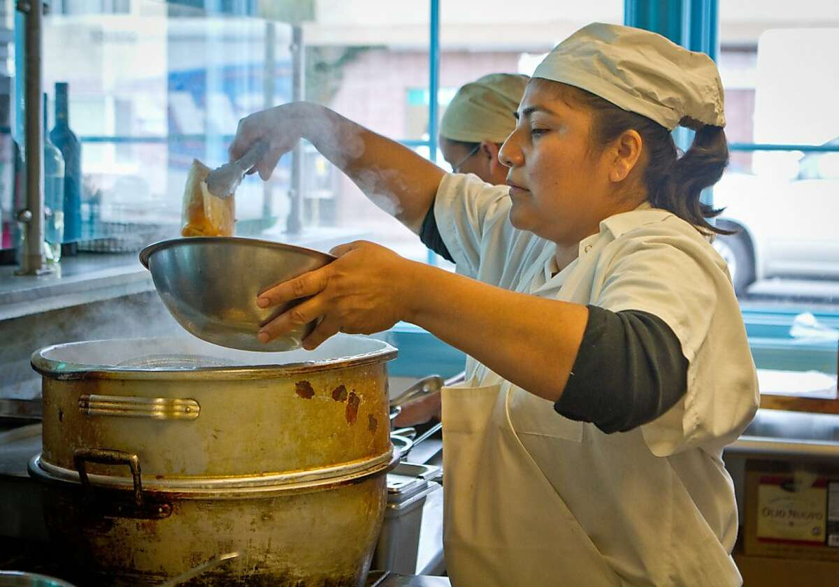 Zirida Juarez pulls Tamles from the steamer at El Molina Central in Boyes Hot Springs, Calif. on April 12th, 2012.
