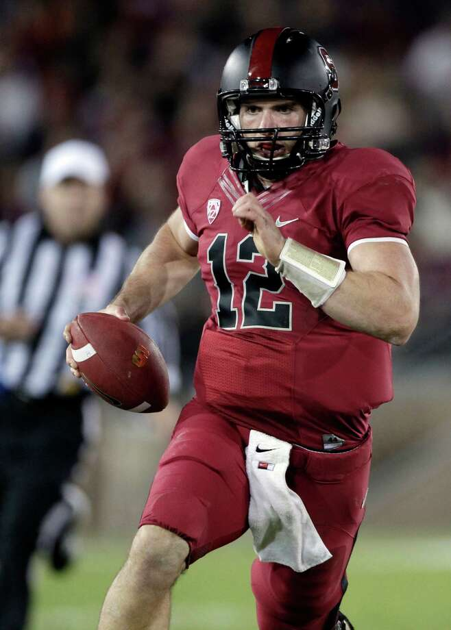 FOR USE AS DESIRED WITH NFL DRAFT STORIES - FILE - In this Nov. 26, 2011, file photo, Stanford quarterback Andrew Luck (12) runs with the ball during the second quarter of an NCAA college football game in Stanford, Calif. Luck is a top prospect in the upcoming NFL football draft. Photo: AP