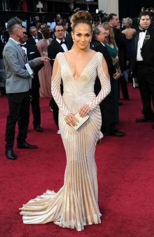 Tip: Wear this dress and you'll never be allowed inside.   (Jennifer Lopez) (Michael Buckner / Getty Images)