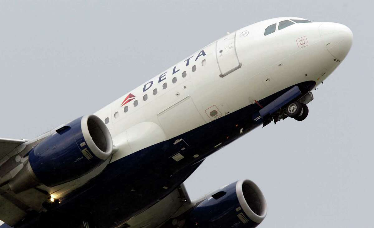 FILE - In this July 22, 2011 file photo, a Delta Air Lines jet takes off at the Detroit Metropolitan Airport in Romulus, Mich. (AP Photo/Carlos Osorio, File)