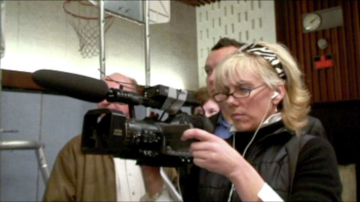 Rielle Hunter films John Edwards after a rally in New Hampshire in 2006. She was fired after Elizabeth Edwards learned of the affair.
