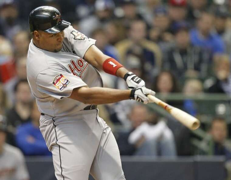 Houston Astros' Carlos Lee watches his RBI single against the Milwaukee Brewers during the second in