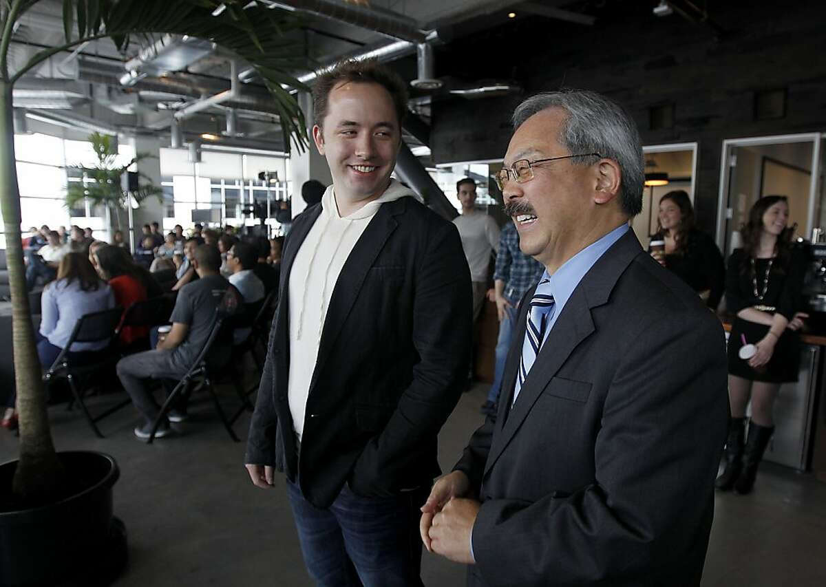 Dropbox founder Drew Houston gives a personal tour to Mayor Ed Lee at the company's spacious new headquarters in San Francisco, Calif. on Wednesday, April 25, 2012.