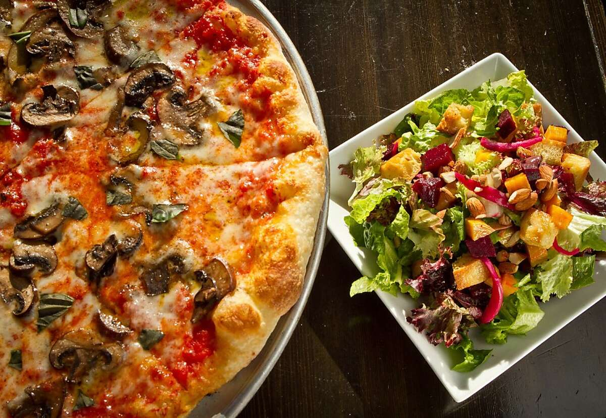 The wild Mushroom Pizza and the Ligurian Beet Salad at Divino Restaurant in Berkeley, Calif. is seen onThursday, April 19th, 2012.