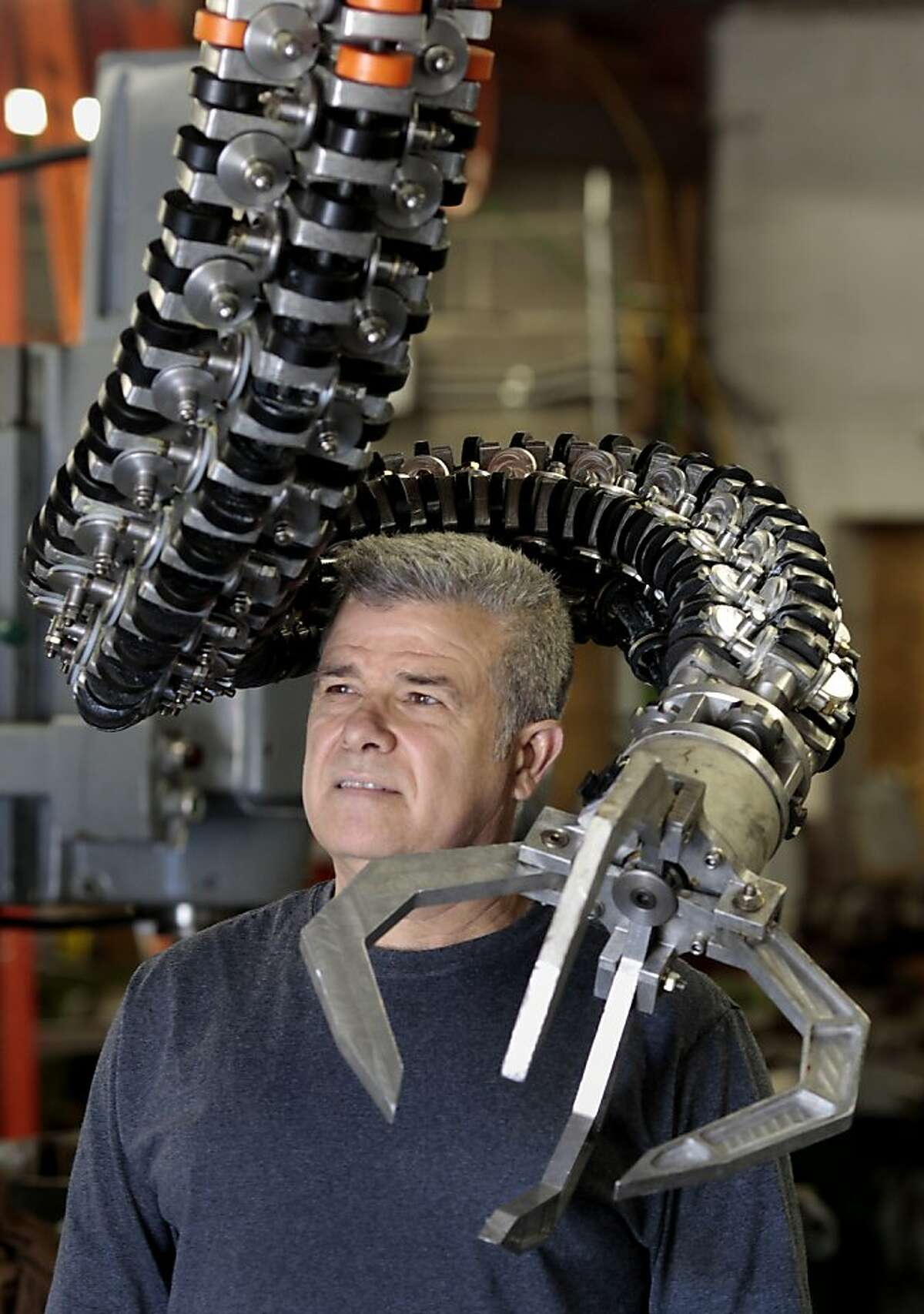 Mark Pauline stands near his spine machine, which is a robotic arm capable of flinging objects great distances. Legendary machine man Mark Pauline has moved his Survival Research Laboratories to Petaluma, Calif. where he continues to design and create his one-of-a-kind machines.
